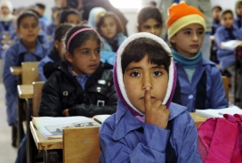 Children inside a classroom at Za'atri refugee camp, host to tens of thousands of Syrians displaced by conflict, near Mafraq, Jordan / Photograph:  UN Photo/Mark Garten, Flickr
