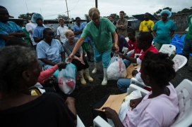 Doctors Without Borders staff distribute take-home kits for Ebola survivors. Photo: Morgana Wingard, Flickr