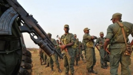 Nigerian soldiers in their fight against Boko Haram. AI accuses the army.