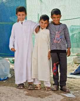 Refugge kids stand together. Doctors without borders.