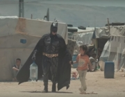 Batman visiting a refugee camp. Photo: Youtube