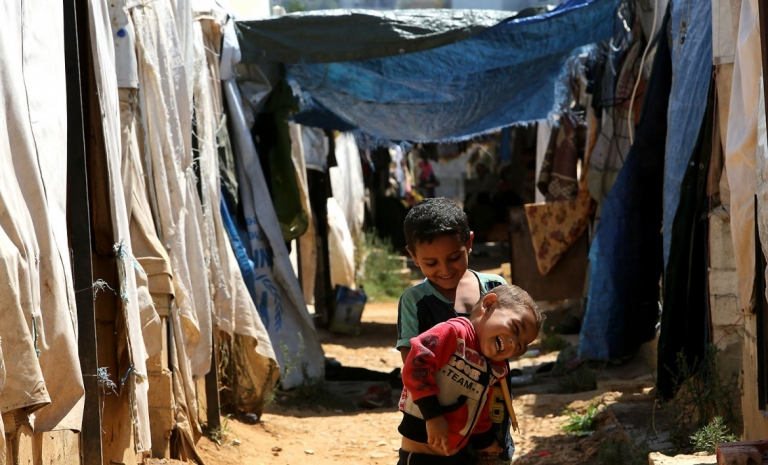 In displacement camps, the implementation of basic infection prevention and control measures can be challenging due to the scarcity of resources.