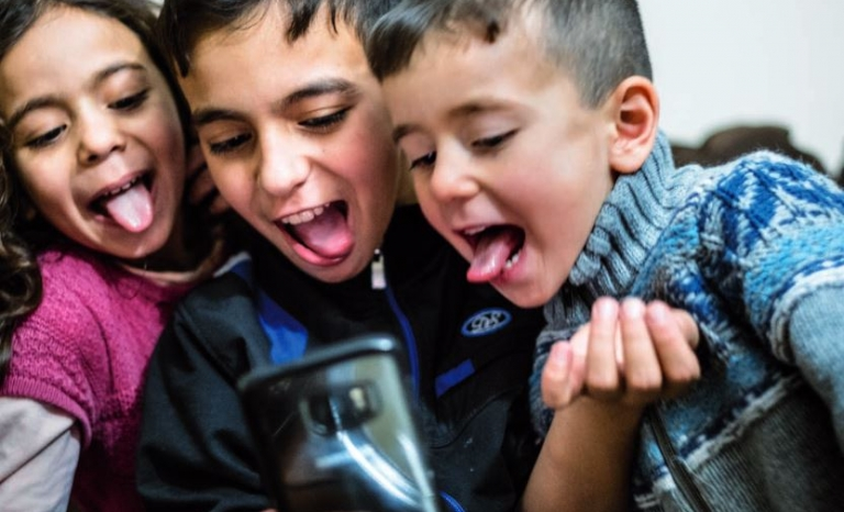 Access to the Internet may help more vulnerable children to develop their potential and find references.  Source:UNICEF