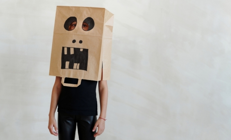 A person with a paper bag on his head.