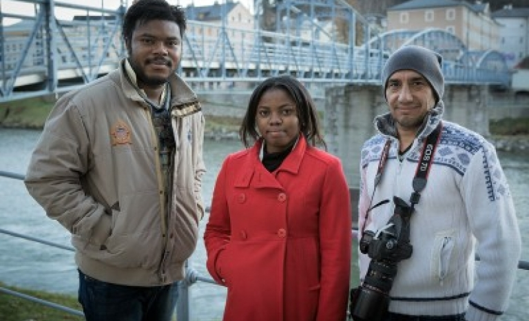 Three members of refugee.tv team: Newton Osaruoname Idemudia (cameraman) Olivia Christopher (presenter) and Fathi Ghanim (cameraman) / Photograph: refugee.tv