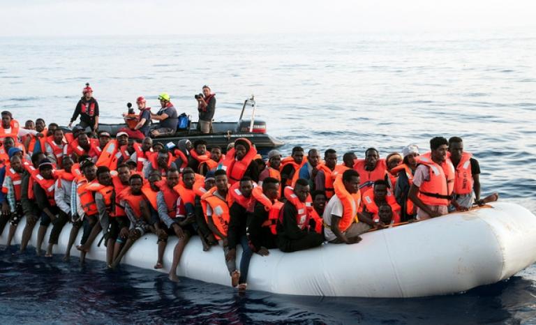 Dozens of Sub-Saharan migrants in a small dinghy