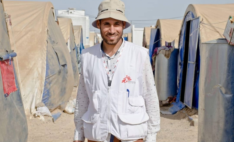 Ali is a proud health worker at a refugee camp. Doctors without borders.