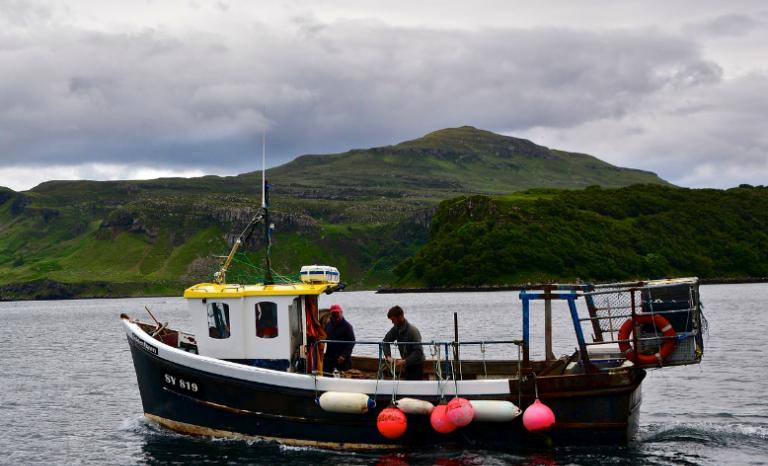 Fishermen in Portree, Isle of Skye (Scotland) / Photograph: Antonio Cinotti, Flickr