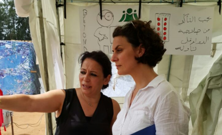 Maria Khayat Assi, CEO of BEYOND Association, with a WHO officer in a field visit / Photograph: BEYOND Association