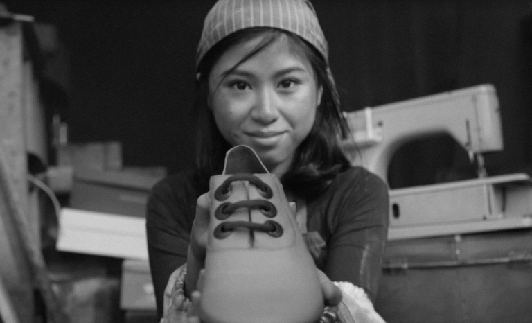 """Frame of """"Change your shoes"""" campaign video / Labour Behind The Label"""