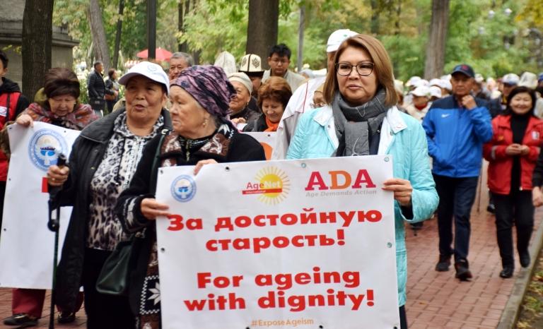 Older people on a street march against ageism in Bishkek, Kyrgyzstan.