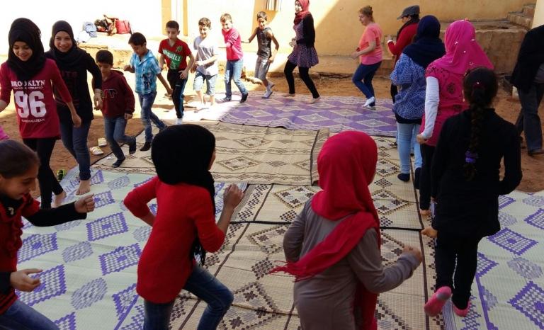 Playing / Photograph: BEYOND Association