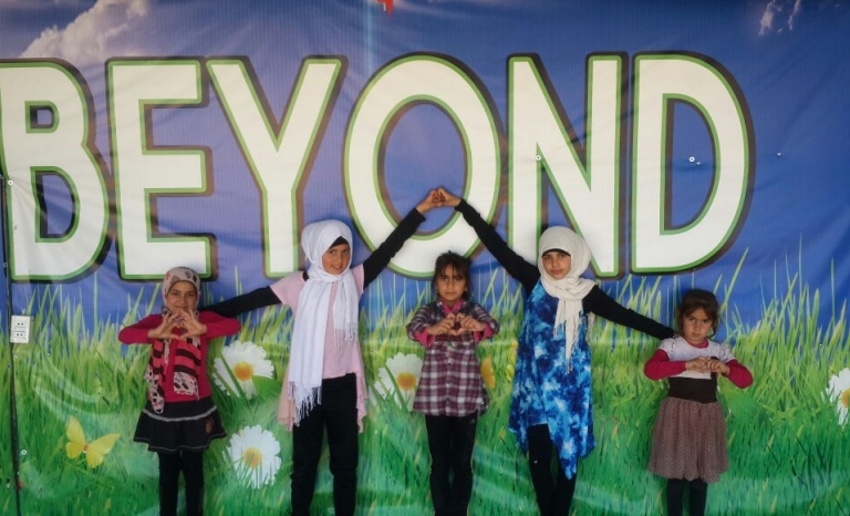 Children with BEYOND Association's logo / Photograph: BEYOND Association