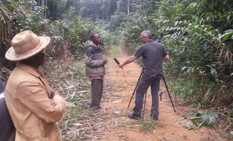 "Michel Peremans interviewing a forester for the film ""A change for change"" in the Congo / Photograph: Fern"