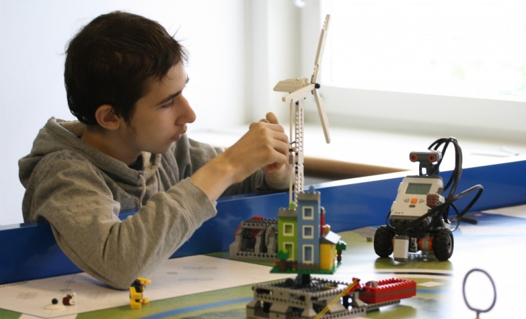 Young boy with autism in a training. Photo: Specialisterne Foundation