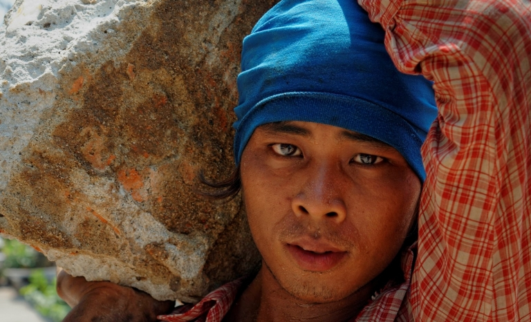 Worker suffering slavery conditions. Photo: 50 for Freedom