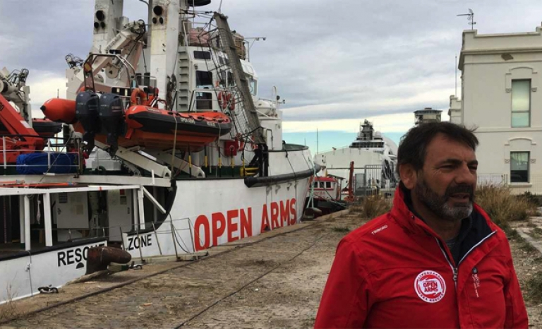 Òscar Camps in front of the Open Arms tied to the port of Barcelona on Monday.