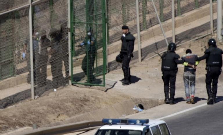 Immigrants entering the Zona Franca's CIE.