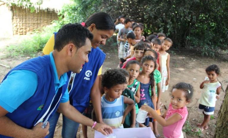 Cooperators for Plan International. Photo: Plan International