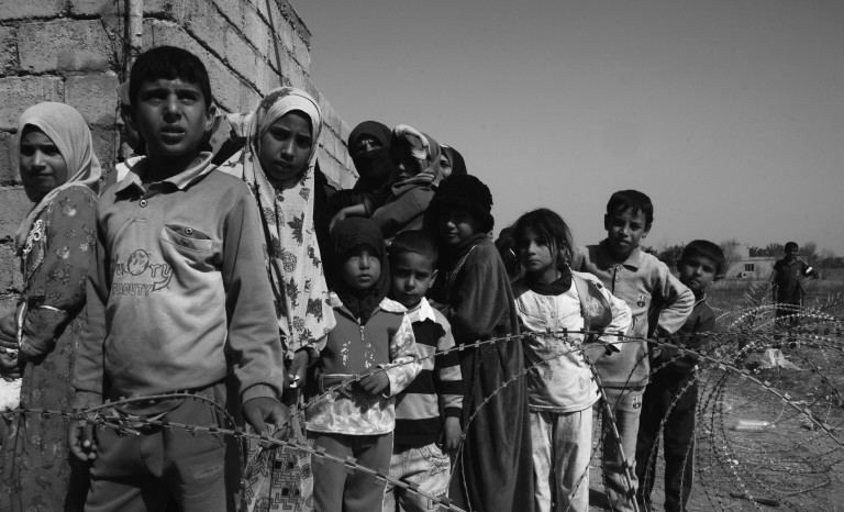 Refugees awaiting for food. Photo: Wikipedia