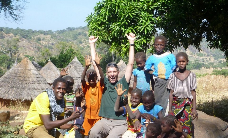Sidi and children having a good time in Kédougou. Photo: YAA