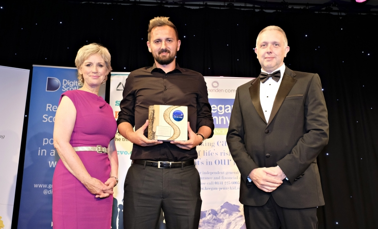 David Duke, founder and CEO of the project, receiving the Charity of the Year Award. Photo: SCVO
