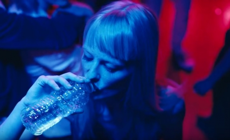 Girl drinking water in a disco. Image: FCC