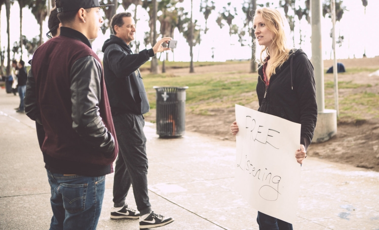 Volunteer offering people the chance to be heard. Image: Urban Confessional
